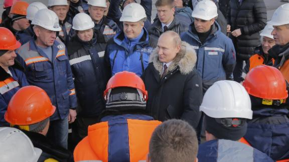 Putin inspects the Crimean Bridge over the Kerch Strait.