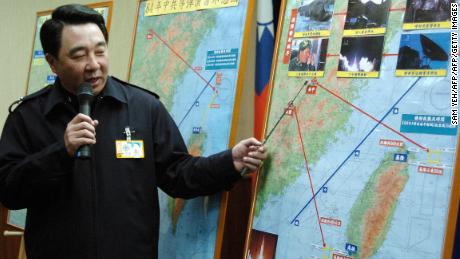 Taipei, TAIWAN:  Taiwan's defense ministry spokesman Liou Chih-jein during a press conference at Taipei 07 March 2006, shows a map across the Strait as the ministry releases satellite photos and data featuring the 1996 missile crisis.  China loaded ballistic missiles into waters off the island and held wargames to scare Taiwanese voters not to vote for Lee Teng-hui, then the president seeking another four-year term.   AFP PHOTO/Sam YEH  (Photo credit should read SAM YEH/AFP/Getty Images)