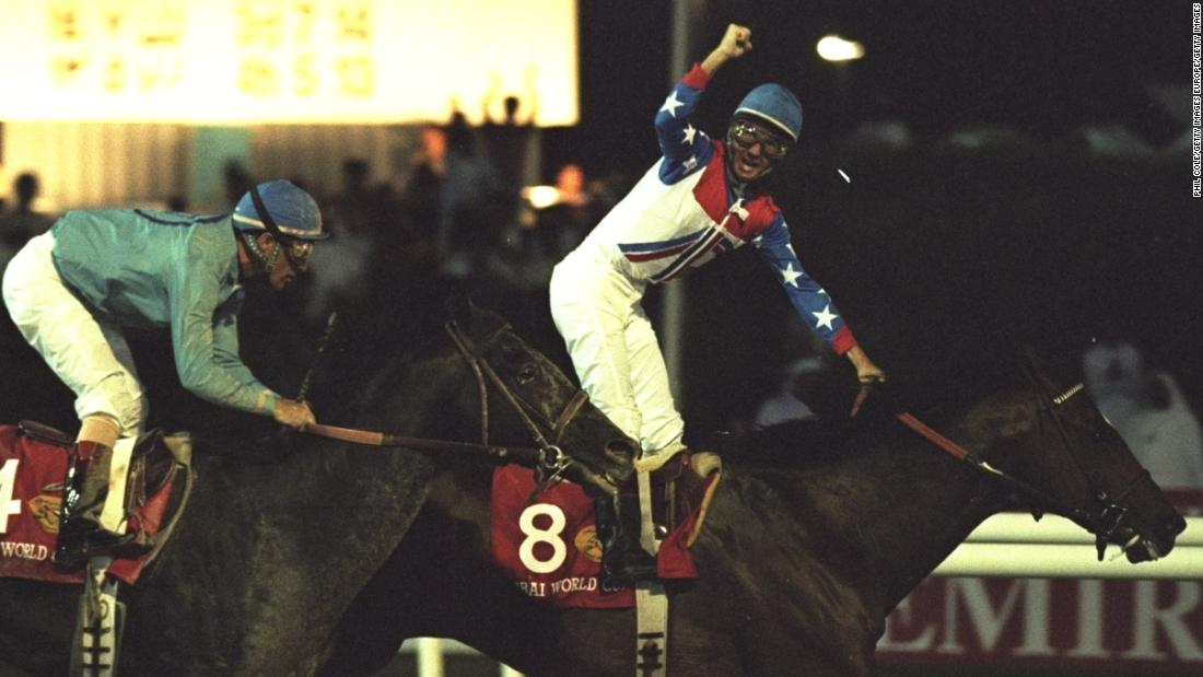 American rider Gerry Bailey salutes the crowd as he wins the inaugural Dubai World Cup on Cigar in 1996.