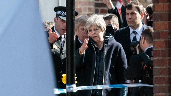 British Prime Minister Theresa May, center, on Thursday, March 15, 2018, visits the location in Salisbury, England, where Sergei Skripal and his daughter Yulia were discovered.