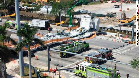 Emergency personnel responds to a collapsed pedestrian bridge connecting Florida International University Florida International on Thursday, March 15, 2018 in the Miami area.