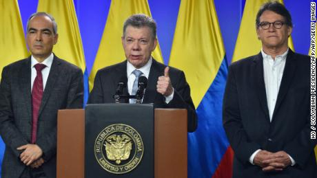 Handout picture released by the Colombian presidency's press office shows Colombian President Juan Manuel Santos (C) speaking next to Peace Commissioner Rodrigo Rivera (L) and Gustavo Bell (R).  Santos ordered government negotiators to resume talks with the South American country's last active rebel group, the National Liberation Army (ELN). / AFP PHOTO / HO / Colombian PresidencyHO / COLOMBIAN PRESIDENCY/AFP/Getty Images