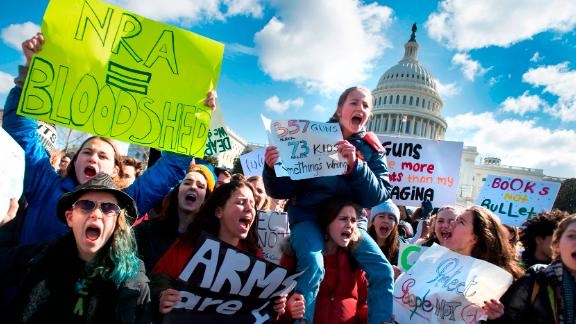 """Students participate in a rally with other students from DC, Maryland and Virginia in their Solidarity Walk-Out to urge Republican leaders in Congress """"to allow votes on gun violence prevention legislation."""" on Capitol Hill in Washington, DC, March 14, 2018.Students across the US walked out of classes on March 14, in a nationwide call for action against gun violence following the shooting deaths last month at a Florida high school. The nationwide protest is being held one month to the day after Nikolas Cruz, a troubled 19-year-old former student at Stoneman Douglas, unleashed a hail of gunfire on his former classmates. / AFP PHOTO / JIM WATSON        (Photo credit should read JIM WATSON/AFP/Getty Images)"""