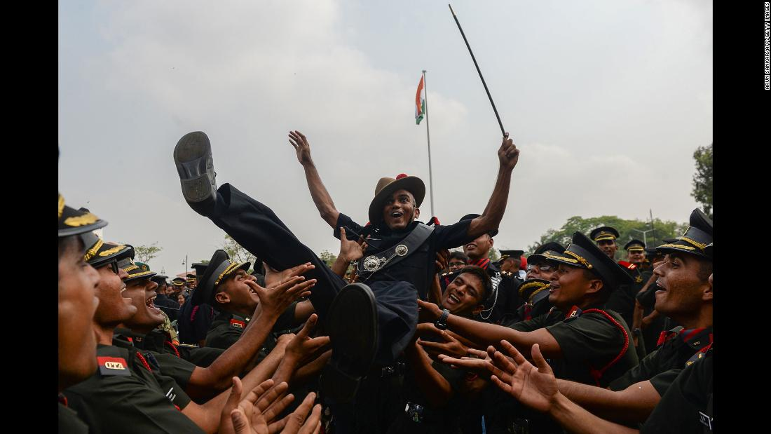 Army cadets celebrate after their graduation ceremony in Chennai, India, on Saturday, March 10.