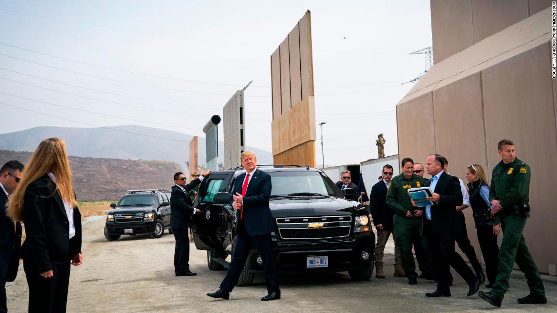 "US President Donald Trump arrives in the San Diego neighborhood of Otay Mesa <a href=""https://www.cnn.com/2018/03/13/politics/trump-border-wall-prototypes-visit/"" target=""_blank"">to view border-wall prototypes</a> on Tuesday, March 13."