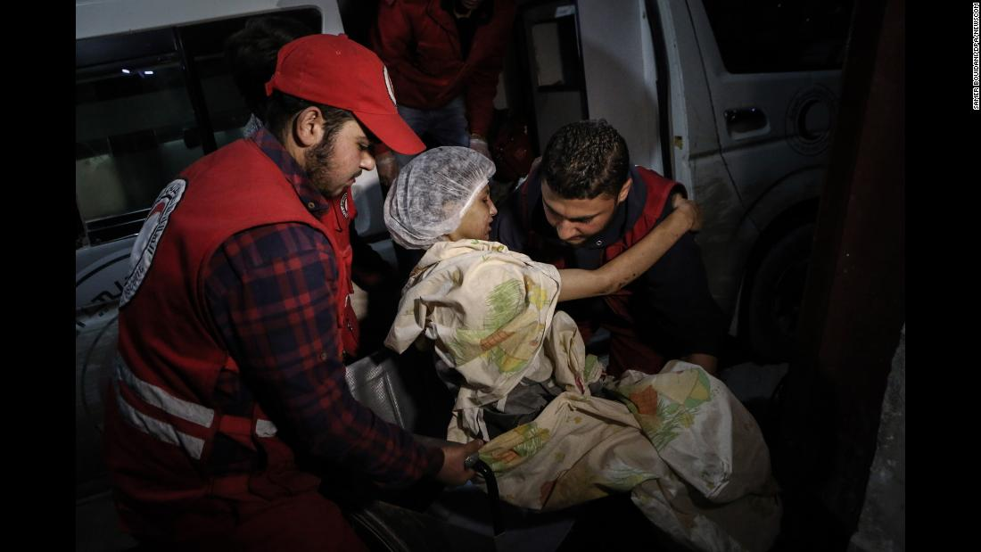 "A young woman is transported by members of the Syrian Arab Red Crescent during evacuations from Douma to Damascus on Wednesday, March 14. <a href=""https://www.cnn.com/2018/03/15/middleeast/eastern-ghouta-civilians-flee-exodus-intl/index.html"" target=""_blank"">Thousands of people have fled</a> the besieged area of Eastern Ghouta as Syrian forces advance into the rebel-held enclave. <a href=""https://www.cnn.com/interactive/2018/03/world/syria-eastern-ghouta-cnnphotos/index.html"" target=""_blank"">More photos: Witnessing horror in Eastern Ghouta</a>"