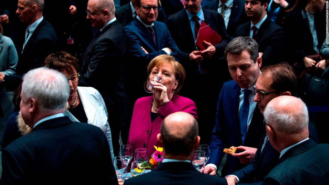 "German Chancellor Angela Merkel has a drink in Berlin after a coalition contract was signed for Germany's new government on Monday, March 12. A couple days later, <a href=""https://www.cnn.com/2018/03/14/europe/merkel-chancellor-fourth-term-germany-intl/index.html"" target=""_blank"">lawmakers voted to re-elect Merkel</a> for a fourth term. <a href=""https://www.cnn.com/2013/09/19/europe/gallery/angela-merkel-career/index.html"" target=""_blank"">See photos of Merkel's life and career</a>"