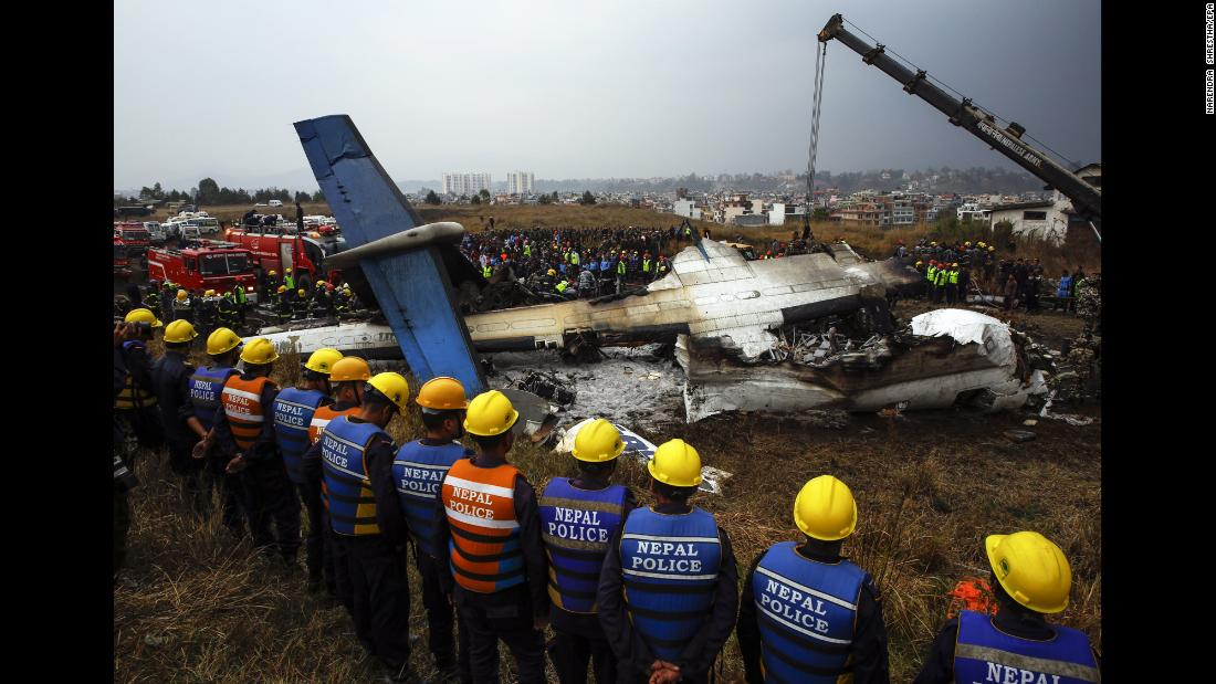 "Rescue teams surround the wreckage of a plane that crashed while landing at the Tribhuvan Airport in Kathmandu, Nepal, on Monday, March 12. Flight BS 211, which was flying in from Dhaka, Bangladesh, <a href=""https://www.cnn.com/2018/03/12/asia/kathmandu-plane-crash/index.html"" target=""_blank"">crashed and burst into flames</a> after approaching the runway from the wrong direction, officials said. Dozens were killed."