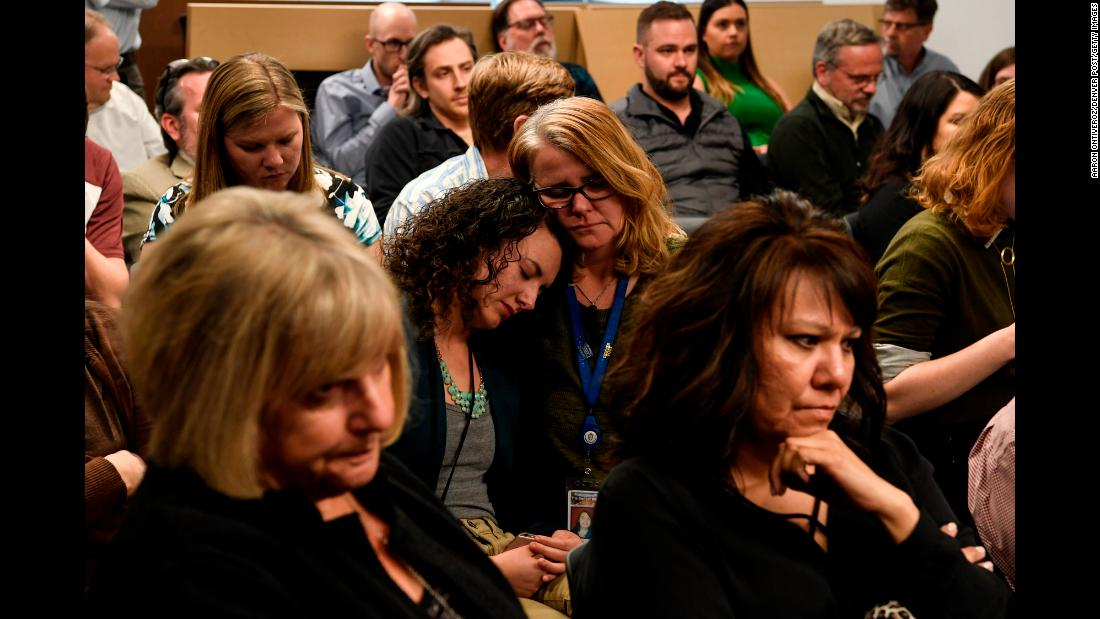 "Noelle Philipps, center right, consoles fellow reporter Elizabeth Hernandez as <a href=""https://www.denverpost.com/2018/03/14/denver-post-layoffs/"" target=""_blank"">layoffs were announced to the Denver Post newsroom</a> on Wednesday, March 14. Editor Lee Ann Colacioppo announced that 30 newsroom employees would be laid off by April. The newspaper has about 100 newsroom employees right now."