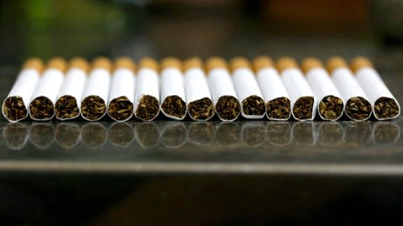 A picture taken on September 29, 2017 shows a close up shot a stack of cigarettes in Kuwait City. On October 1, 2017, the United Arab Emirates will double the price of tobacco and increase soft drink prices by 50 percent, ahead of a more general tax on goods and services on January 1 next year. It is but one of the six Gulf Cooperation Council states -- along with Saudi Arabia, Bahrain, Kuwait, Oman and Qatar -- to introduce the five-percent VAT next year as they seek to redress their economies.  / AFP PHOTO / Yasser Al-Zayyat        (Photo credit should read YASSER AL-ZAYYAT/AFP/Getty Images)