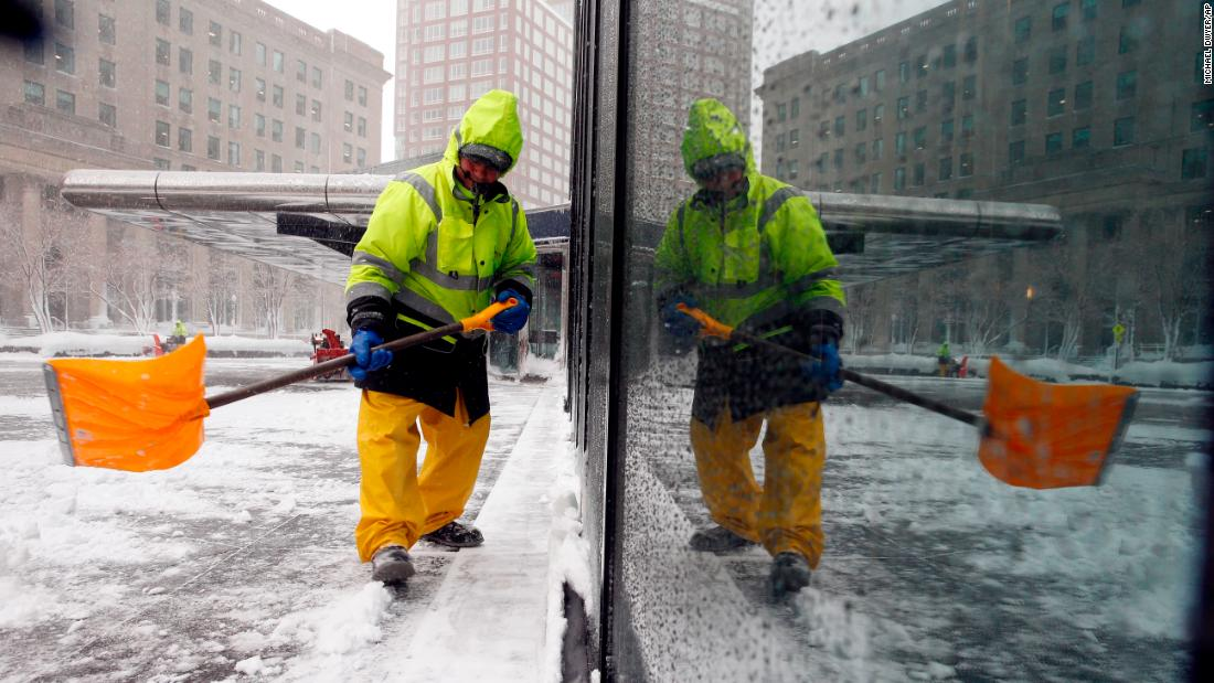 "A worker shovels snow in Boston on Tuesday, March 13. New England was dealing with <a href=""https://www.cnn.com/2018/03/13/weather/northeast-winter-storm/index.html"" target=""_blank"">its third nor'easter in two weeks.</a>"