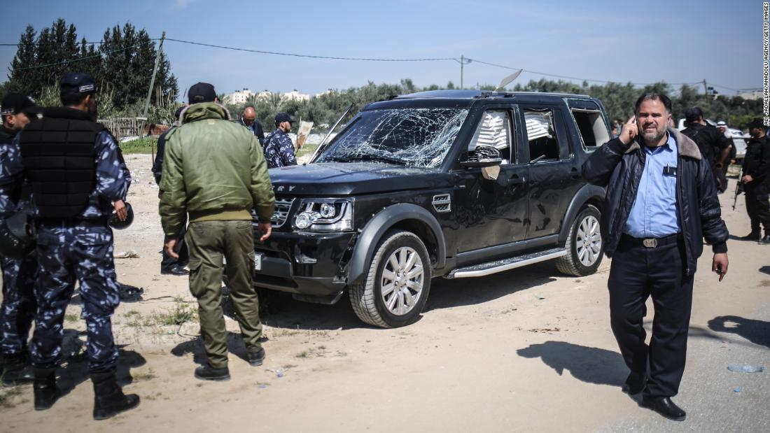 "Palestinian security officials inspect a damaged car in Gaza after <a href=""https://www.cnn.com/2018/03/13/middleeast/palestinian-pm-gaza-explosion-intl/index.html"" target=""_blank"">a bomb detonated</a> near the convoy of Palestinian Prime Minister Rami Hamdallah on Tuesday, March 13. No one was injured in the attack."