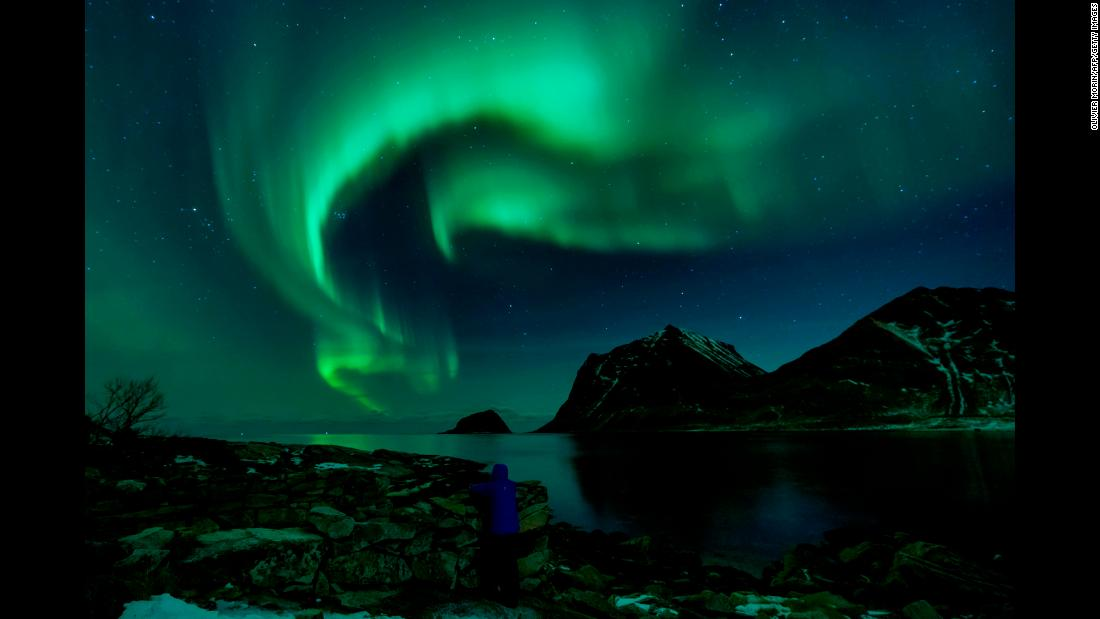 A person watches the Northern Lights in Utakleiv, Norway, on Friday, March 9.