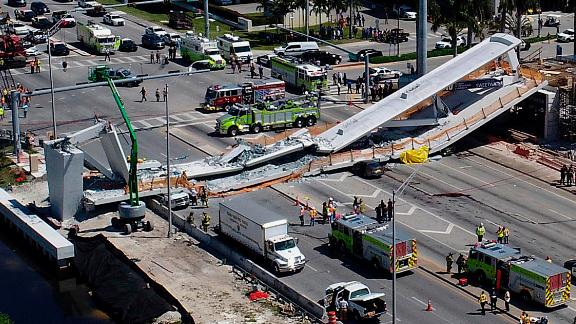 Emergency personnel respond to a deadly bridge collapse in Miami on Thursday, March 15. The bridge was installed Saturday at Florida International University.