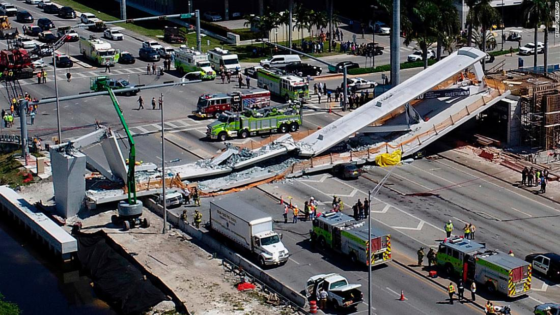 "Emergency personnel respond to a <a href=""https://www.cnn.com/2018/03/16/us/bridge-collapse-florida/index.html"" target=""_blank"">deadly bridge collapse in Miami</a> on Thursday, March 15. The bridge was installed Saturday at Florida International University."