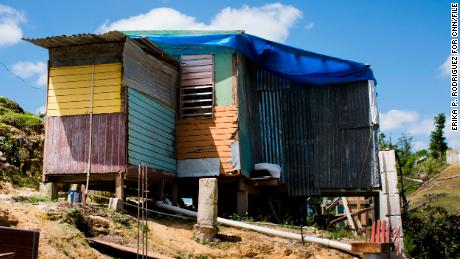 Herminio Trinidad Agosto's home in Corozal, P.R., on March 13, 2018. On Feb. 13, 2018, Zoraida Santiago Torres, 58, TrinidadÕs wife died from a pulmonary disease. The family, including two sons of Santiago, live in home made with the scraps of what was left after hurricane Maria flattened the house at a hill top of Corozal. Almost six months after hurricane Maria ravaged the island over 200 thousand people remain without power. Some recent deaths have been linked to the lack of electric service, but most are not recognized as a hurricane Mara death. (Erika P. Rodriguez for CNN)