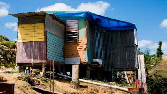 In March, months after Hurricane Maria, a family was living in this house made from scraps in Corozal.