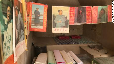 "Posters of Mao Zedong and other reproduced Cultural Revolution-era articles are on display in several ""cave houses"" that Xi lived in the village."