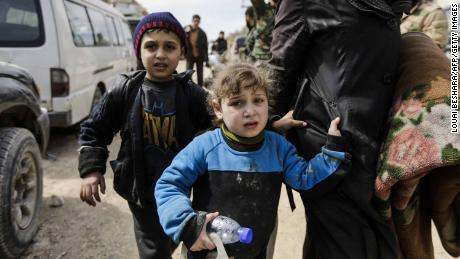 As thousands flee assaults in Syria, rebels won't let others out