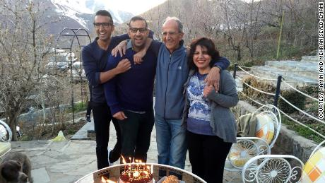 Ramin and Mehran Seyed-Emami with their father Kavous, who died in a Tehran prison, and mother Maryam.