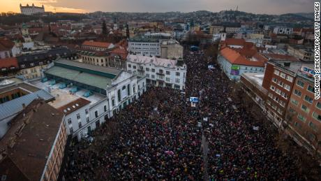 People gather near the Slovak National Uprising square in Bratislava on Friday.