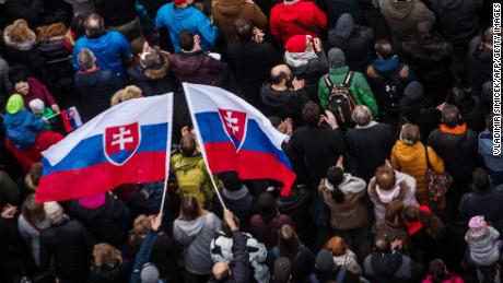 Protesters pay tribute to slain Slovak journalist Jan Kuciak and his fiancée, Martina Kušnírová.