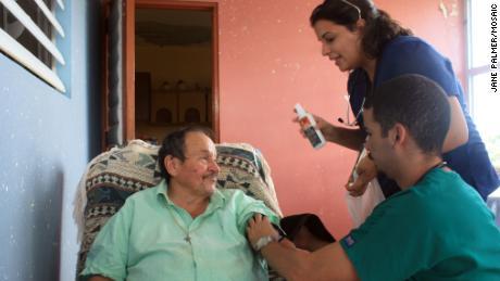 Medical students Monica Abreu and Carlos Rodriquez perform basic health checks on a Montones resident.
