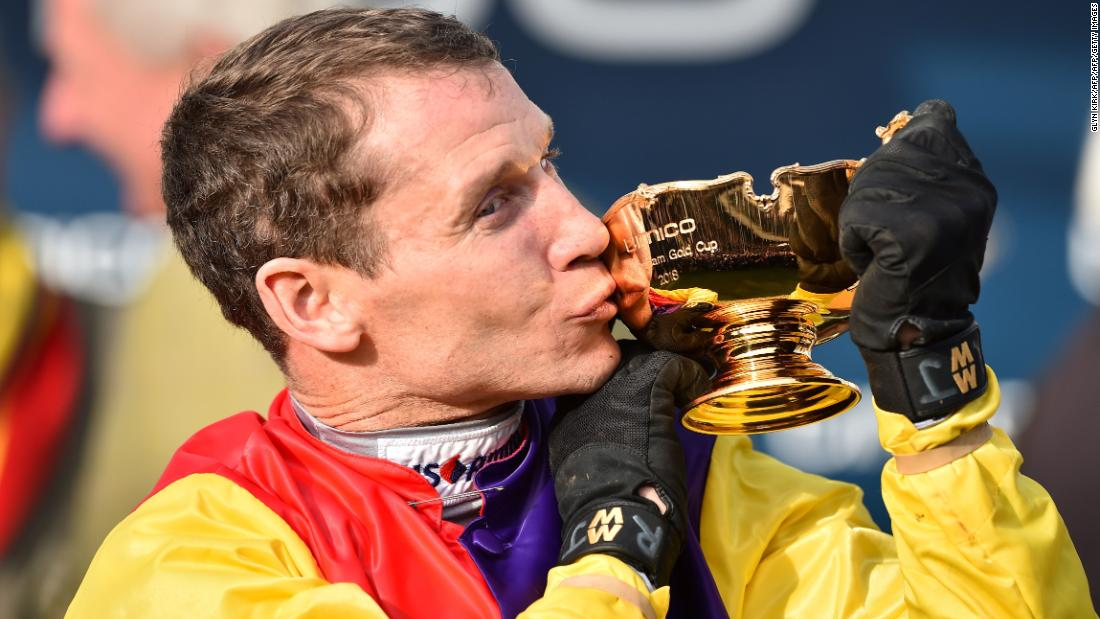 "<strong>Long overdue: </strong>Winning jockey Richard Johnson, 40, saluted his ""fantastic horse"" -- trained by Colin Tizzard -- after winning his second Gold Cup 18 years after his first on Looks Like Trouble in 2000."