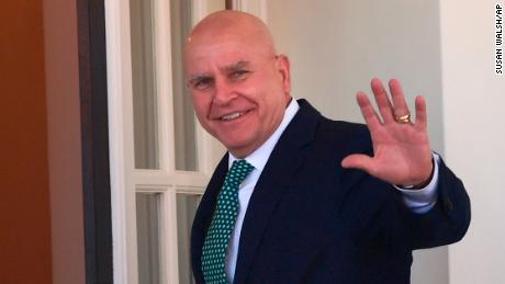 National security adviser H.R. McMaster waves as he walks into the West Wing of the White House in Washington, Friday, March 16, 2018.