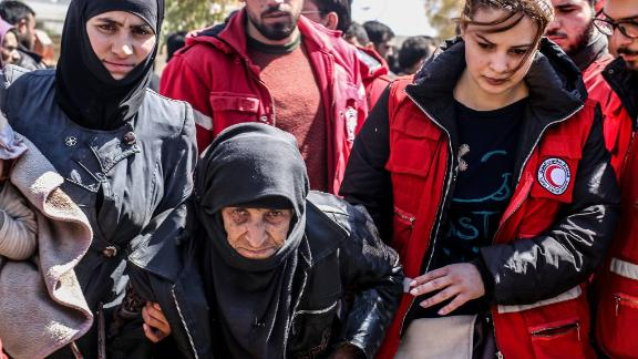 Syrian Arab Red Crescent workers help a woman this week in Eastern Ghouta.