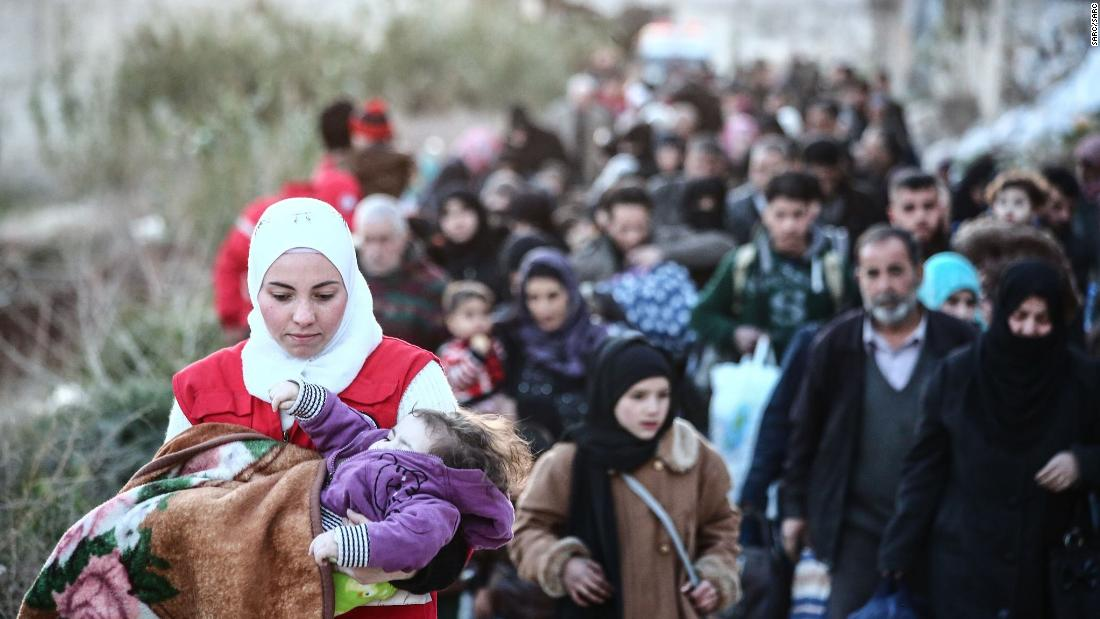 Airstrikes hit Syrian enclave where thousands are fleeing, activist group says