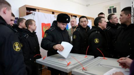 Military sailors cast their ballots at a polling station in the Russian far eastern port city of Vladivostok.