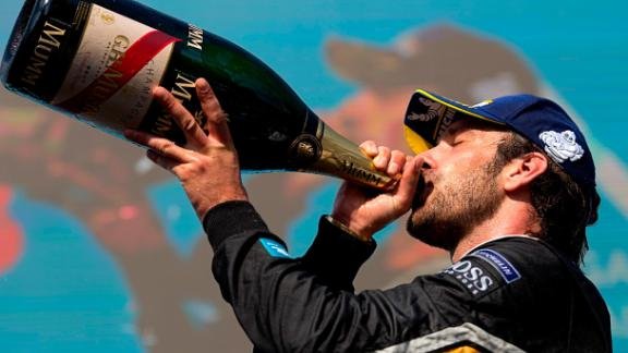 Vergne celebrated with a swig of champagne.