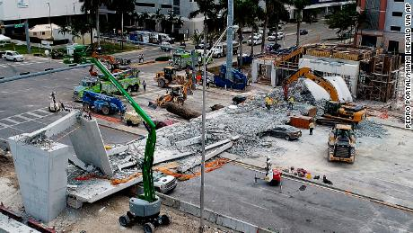 Recovery operations continue Saturday morning, March 17, 2018, at the site of the Florida International University-Sweetwater University bridge in the Miami area that collapsed during construction earlier in the week. (Pedro Portal/Miami Herald via AP)