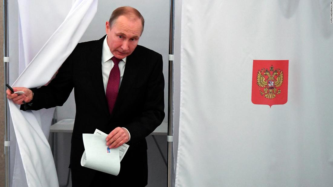 Putin wins 6 more years in power, exit polls show