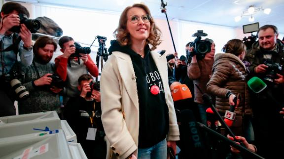 Presidential candidate Ksenia Sobchak smiles as she speaks to the media after voting during the Russian presidential election in Moscow.