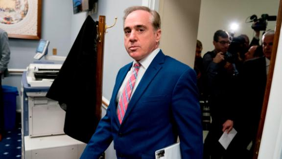 Veterans Affairs Secretary David Shulkin, center, arrives for a House Appropriations subcommittee hearing on Capitol Hill in Washington, Thursday, March 15, 2018. (AP Photo/Andrew Harnik)