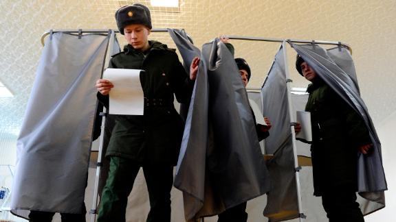 Russian soldiers vote in Rostov-on-Don, Russia on Sunday.