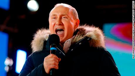 Presidential candidate, President Vladimir Putin addresses the crowd during a rally and a concert celebrating the fourth anniversary of Russia's annexation of Crimea at Manezhnaya Square in Moscow on March 18, 2018. / AFP PHOTO / POOL / Alexander Zemlianichenko        (Photo credit should read ALEXANDER ZEMLIANICHENKO/AFP/Getty Images)