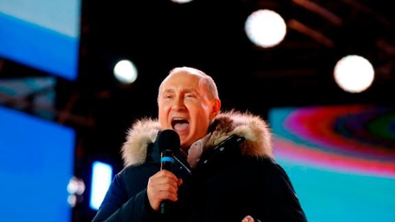 Presidential candidate, President Vladimir Putin addresses the crowd during a rally and a concert celebrating the fourth anniversary of Russia
