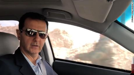 Syrian President Bashar al Assad drives through newly recaptured parts of Eastern Ghouta.