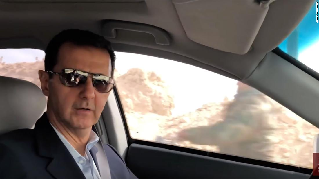 Assad flaunts Ghouta onslaught by driving into recaptured area
