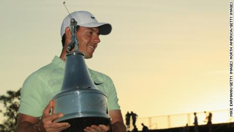 ORLANDO, FL - MARCH 18:  Rory McIlroy of Northern Ireland holds the trophy after his two shot victory during the final round at the Arnold Palmer Invitational Presented By MasterCard at Bay Hill Club and Lodge on March 18, 2018 in Orlando, Florida.  (Photo by Mike Ehrmann/Getty Images)
