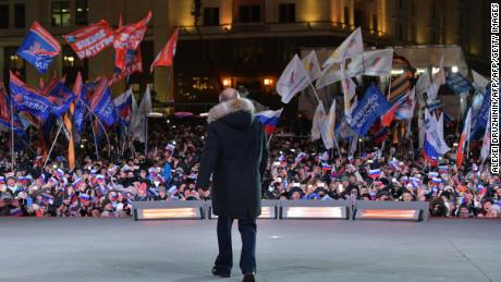 Presidential candidate, President Vladimir Putin addresses the crowd during a rally and a concert celebrating the fourth anniversary of Russia's annexation of Crimea at Manezhnaya Square in Moscow on March 18, 2018. / AFP PHOTO / SPUTNIK / Alexei Druzhinin        (Photo credit should read ALEXEI DRUZHININ/AFP/Getty Images)
