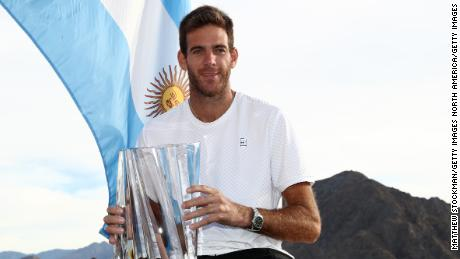 INDIAN WELLS, CA - MARCH 18:  Juan Martin Del Potro of Argentina poses with the winner's trophy after defeating Roger Federer of Switzerland during the men's final on Day 14 of the BNP Paribas Open at the Indian Wells Tennis Garden on March 18, 2018 in Indian Wells, California.  (Photo by Matthew Stockman/Getty Images)