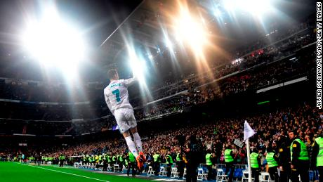 TOPSHOT - Real Madrid's Portuguese forward Cristiano Ronaldo celebrates a goal during the Spanish League football match between Real Madrid CF and Girona FC at the Santiago Bernabeu stadium in Madrid on March 18, 2018. / AFP PHOTO / JAVIER SORIANO        (Photo credit should read JAVIER SORIANO/AFP/Getty Images)