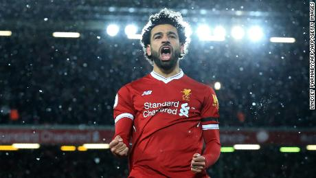 Liverpool's Egyptian midfielder Mohamed Salah celebrates scoring the fourth goal during the English Premier League football match between Liverpool and Watford at Anfield in Liverpool, north west England on March 17, 2018. / AFP PHOTO / Lindsey PARNABY / RESTRICTED TO EDITORIAL USE. No use with unauthorized audio, video, data, fixture lists, club/league logos or 'live' services. Online in-match use limited to 75 images, no video emulation. No use in betting, games or single club/league/player publications.  /         (Photo credit should read LINDSEY PARNABY/AFP/Getty Images)