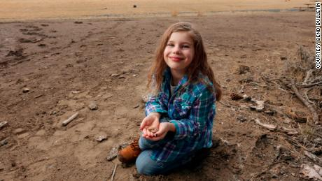 Naomi Vaughan, 7, was digging in the dirt and spotted this ammonite fossil while attending her older sister's soccer game last year. She found it in this very spot.