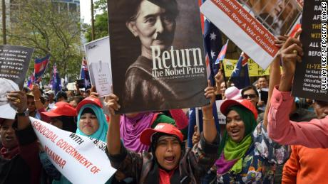 Protesters gather to demonstrate against Suu Kyi during the ASEAN Summit in Sydney on March 17.