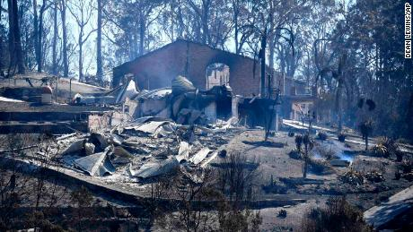 Debris from a destroyed home lays on the ground in town of Tathra, Australia, Monday, March 19, 2018, following a wildfire. More than 70 homes and businesses had been severely damaged or destroyed by a fire that started in woods around midday on Sunday. (Dean Lewins/AAP Image via AP)
